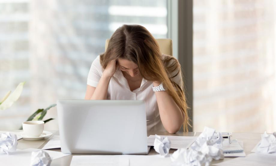Frustrated Woman at Computer Desk