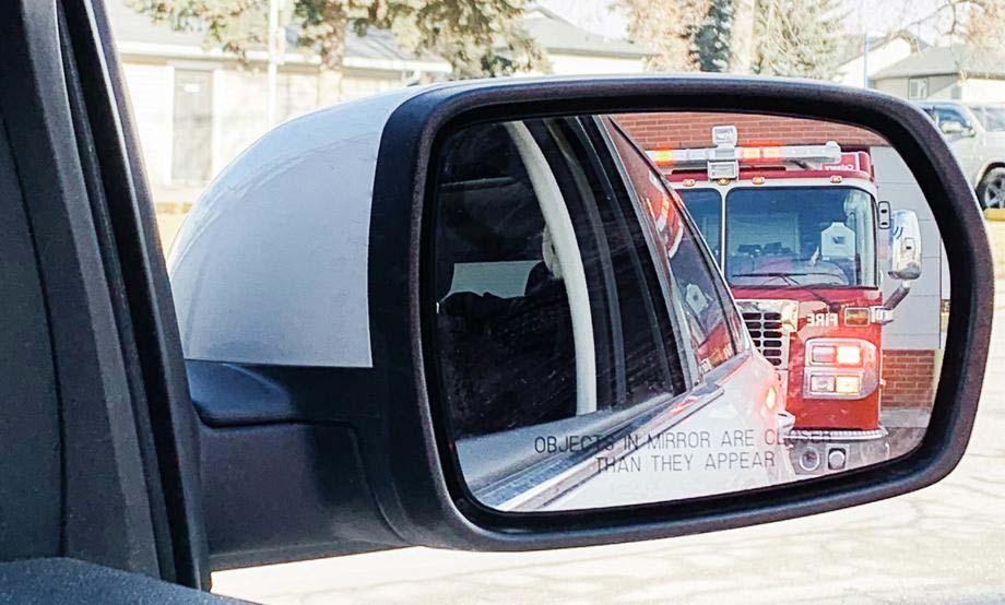 Firetruck in car mirror