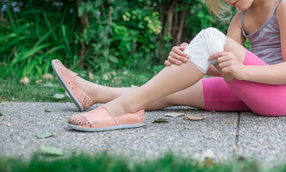 Child with bandaged knee
