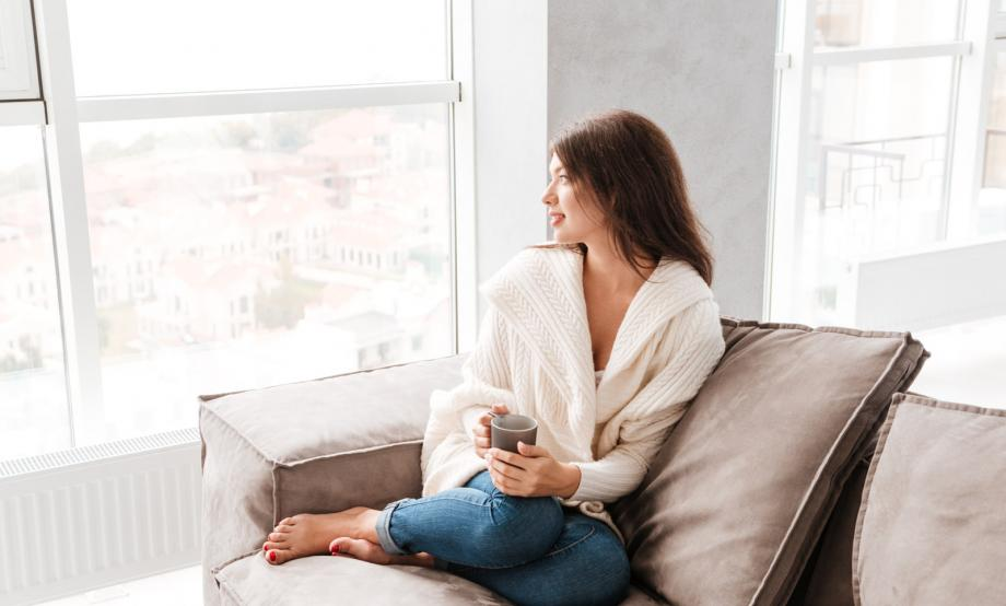 young-woman-with-cup-of-coffee-at-home_HOxamB_Unl.jpg