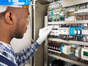 man-working-on-electrical-panel-300x225.jpg