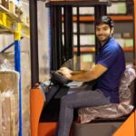Male-warehouse-worker-driving-and-operating-on-forklift-truck-Forklift-safety-training-150x150.jpg
